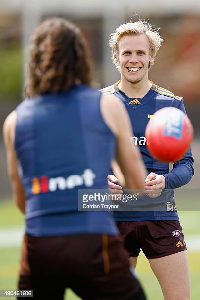Matt Spangher and Will Langford of the Hawks walks out to take part in a Hawthorn Hawks AFL training session at Waverley Park on September 29, 2015...