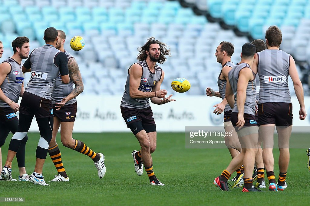 Matt Spangher of the Hawks catches the ball during a Hawthorn Hawks AFL training session at ANZ Stadium on August 29, 2013 in Sydney, Australia.