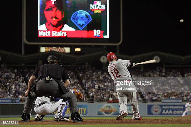 Matt Stairs of the Philadelphia Phillies hits a two-run pinch hit home run in the eighth inning off Jonathan Broxton of the Los Angeles Dodgers to...