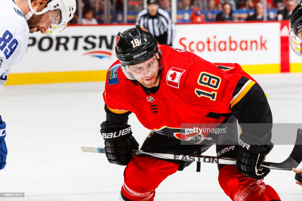 Matt Stajan #18 of the Calgary Flames at face off in a NHL game against the Vancouver Canucks at the Scotiabank Saddledome on December 09, 2017 in Calgary, Alberta, Canada.