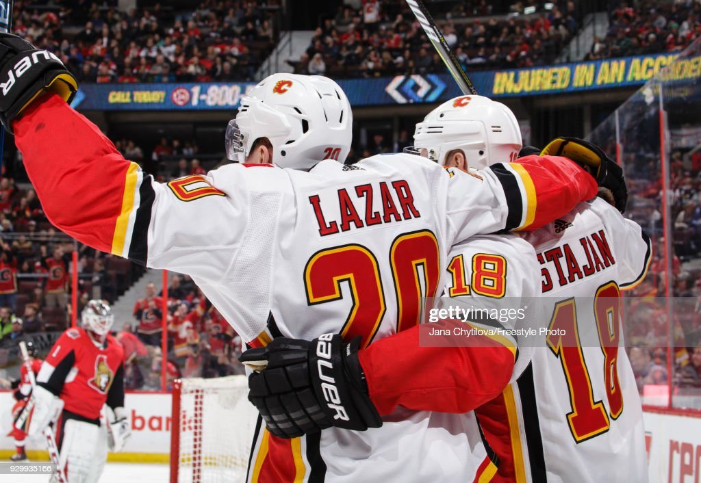 Matt Stajan #18 of the Calgary Flames celebrates his third period goal against the Ottawa Senators with teammate Curtis Lazar #20 at Canadian Tire Centre on March 9, 2018 in Ottawa, Ontario, Canada.