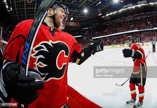 Matt Stajan of the Calgary Flames celebrates with teammate Johnny Gaudreau  after a goal against the 2ea725af3
