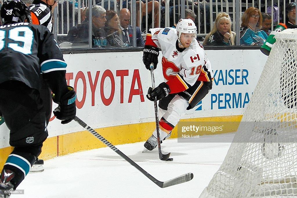 Matt Stajan #18 of the Calgary Flames moves the puck during a NHL game against the San Jose Sharks at SAP Center at San Jose on November 3, 2016 in San Jose, California.