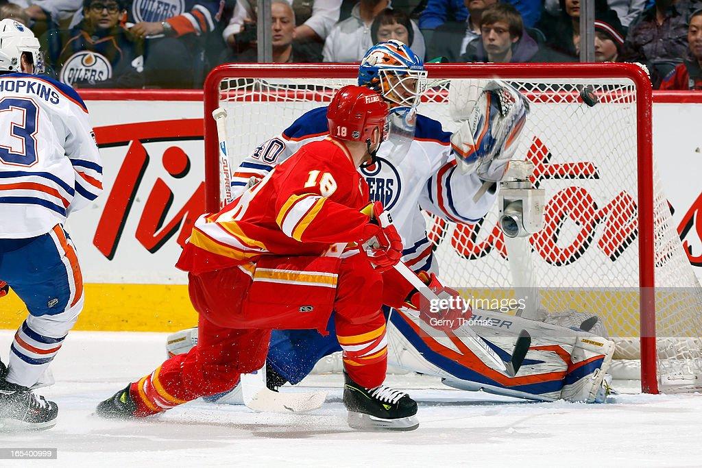 Matt Stajan #18 of the Calgary Flames scores against Devan Dubnyk #40 of the Edmonton Oilers on April 3, 2013 at the Scotiabank Saddledome in Calgary, Alberta, Canada.