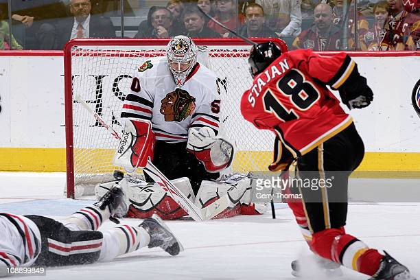 Matt Stajan of the Calgary Flames shoots the puck on Corey Crawford of the Chicago Blackhawks on February 7, 2011 at the Scotiabank Saddledome in...