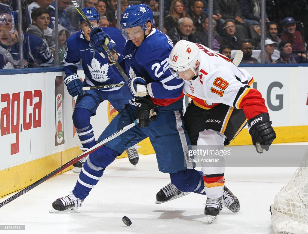 Matt Stajan #18 of the Calgary Flames skates against Nikita Zaitsev #22 of the Toronto Maple Leafs during an NHL game at the Air Canada Centre on December 6, 2017 in Toronto, Ontario, Canada. The Maple Leafs defeated the Flames 2-1 in an overtime shoot-out.