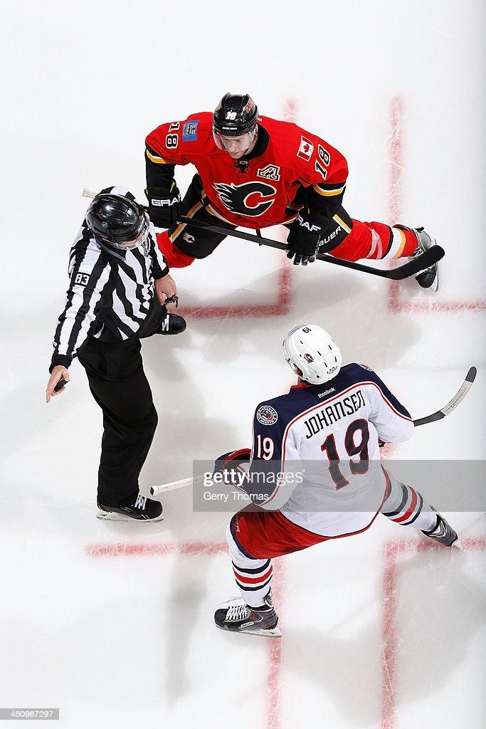 Matt Stajan #18 of the Calgary Flames skates against Ryan Johansen #19 of the Columbus Blue Jackets at Scotiabank Saddledome on November 20, 2013 in Calgary, Alberta, Canada.