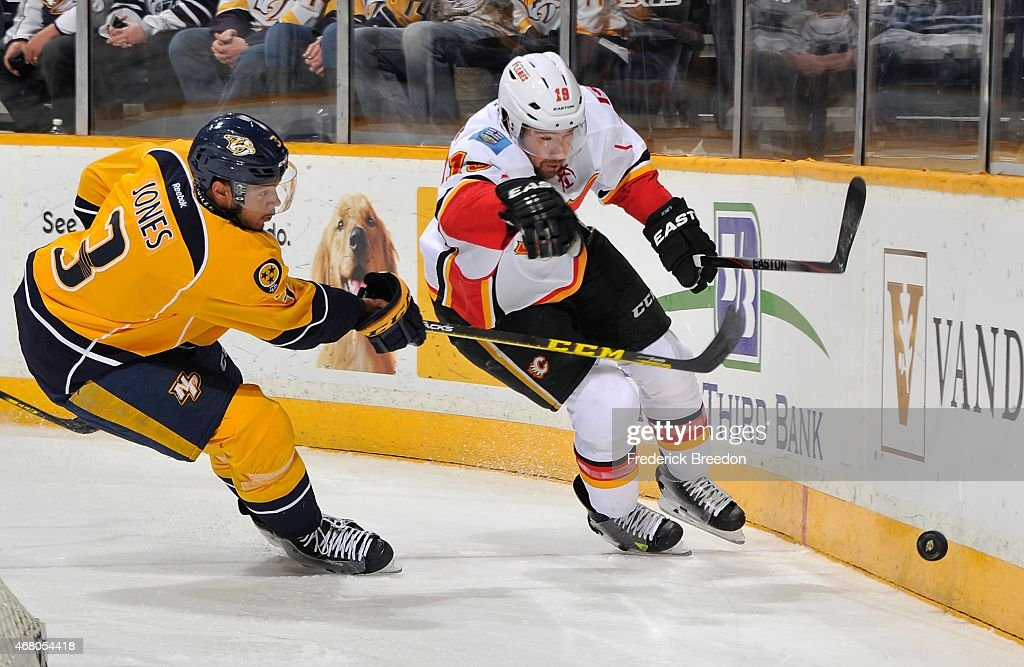 Matt Stajan #18 of the Calgary Flames skates against Seth Jones #3 of the Nashville Predators during the first period at Bridgestone Arena on March 29, 2015 in Nashville, Tennessee.
