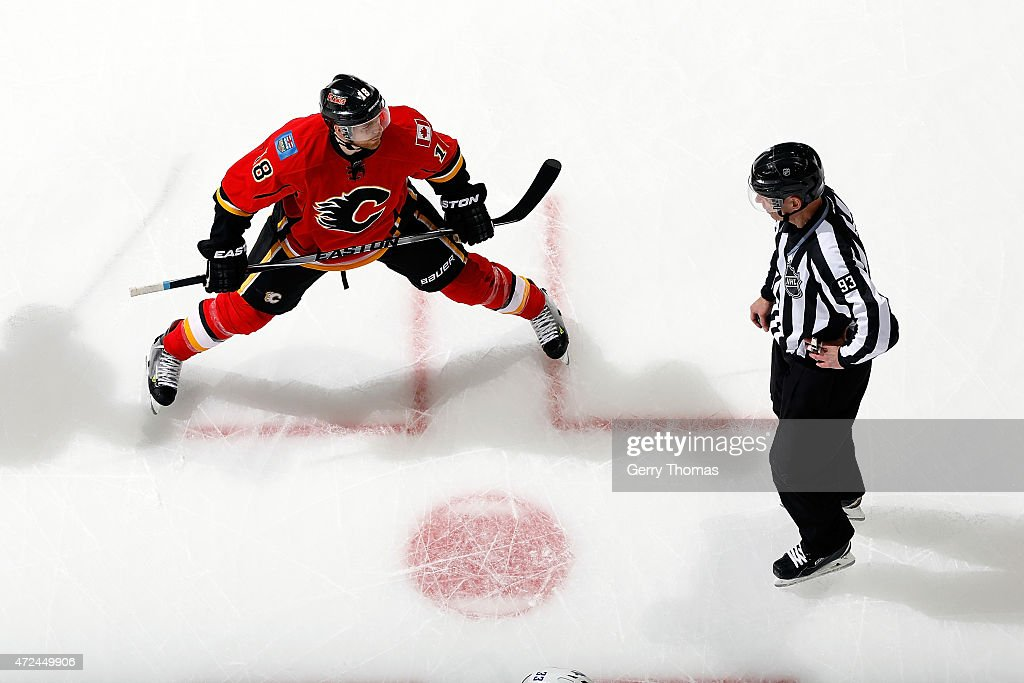Matt Stajan #18 of the Calgary Flames skates against the Vancouver Canucks at Scotiabank Saddledome for Game Four of the Western Quarterfinals during the 2015 NHL Stanley Cup Playoffs on April 21, 2015 in Calgary, Alberta, Canada.