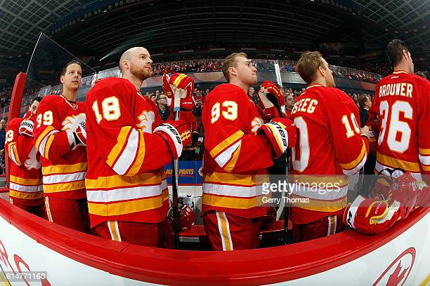 Matt Stajan Sam Bennett and teammates of the Calgary Flames stand for the national anthem before an NHL game against the Edmonton Oilers on October...