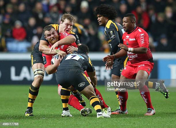 Matt Stevens of Toulon is tackled by Joe Launchbury and George Smith during the European Rugby Champions Cup match between Wasps and Toulon at the...