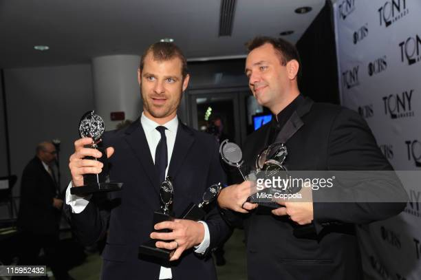 Matt Stone and Trey Parker pose with the award for Best Musical in the press room during the 65th Annual Tony Awards at the The Jewish Community...