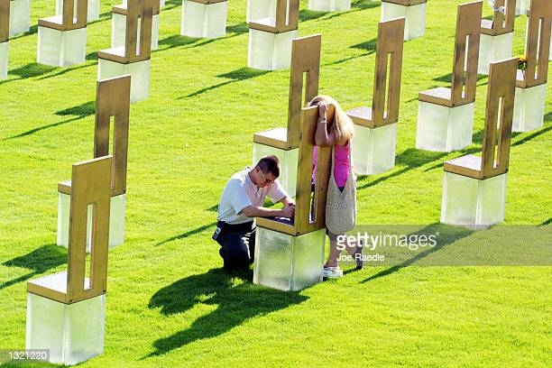 Matt Story with his sister Dawn Mahan mourn at the chair June 11 2001 that represents their mother Frances Williams who was killed in the 1995...