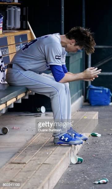 Matt Strahm of the Kansas City Royals sits in the dugout after being pulled during the fourth inning of a game against the Kansas City Royals at...