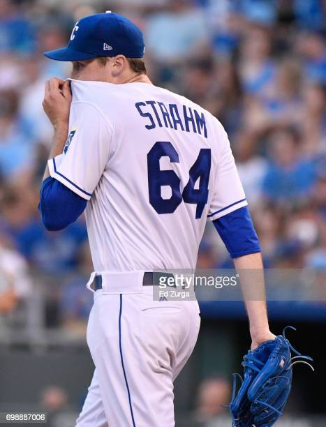 Matt Strahm of the Kansas City Royals wipes his face after giving up a tworun double to Sandy Leon of the Boston Red Sox in the fourth inning at...