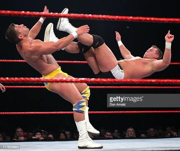 Matt Striker and Harry Smith strike corresponding blows during the WWE RAW Summerslam event at the Acer Arena, Homebush Stadium in Sydney, Australia...