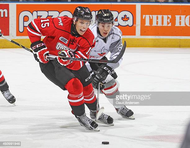 Matt Struthers of the Owen Sound Attack tries to skate away from the checking Kole Sherwood of the London Knights during an OHL game at Budweiser...