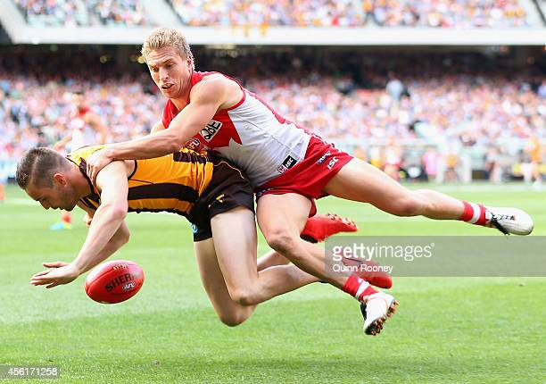 Matt Suckling of the Hawks is tackled by Kieren Jack of the Swans during the 2014 AFL Grand Final match between the Sydney Swans and the Hawthorn...