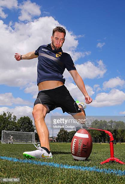 Matt Suckling of the Hawks kicks a Gridiron during a Hawthorn Hawks AFL media opportunity at Gosch's Paddock on January 30, 2015 in Melbourne,...
