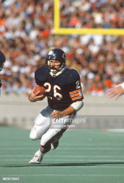 Matt Suhey of the Chicago Bears carries the ball against the Minnesota Vikings during an NFL football game circa 1985 at Soldier Field in Chicago...