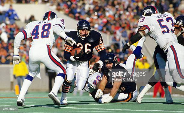Matt Suhey of the Chicago Bears carries the ball in the NFC Divisional Playoff Game against the New York Giants on January 5 1986 in Chicago Illinois