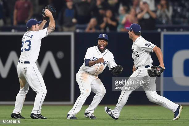 Matt Szczur Manuel Margot and Hunter Renfroe of the San Diego Padres celebrate after the final out during the game against the Atlanta Braves at...