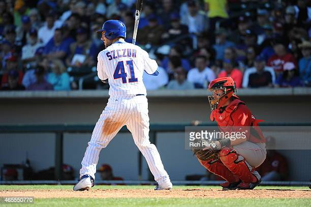 Matt Szczur of the Chicago Cubs bats during the game against the Cincinnati Reds on March 6 2015 at Sloan Park in Mesa Arizona The Reds defeated the...