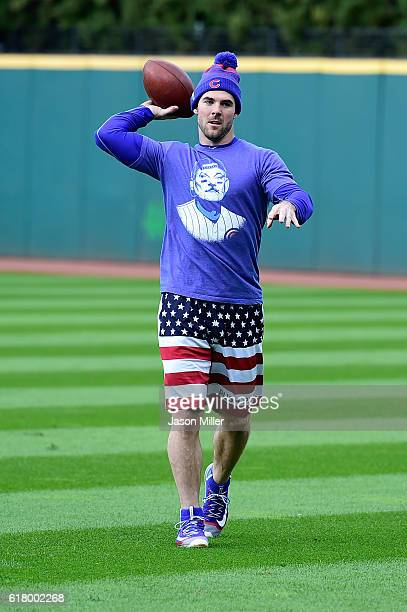 Matt Szczur of the Chicago Cubs plays football in the outfield before taking on the Cleveland Indians in Game One of the 2016 World Series at...