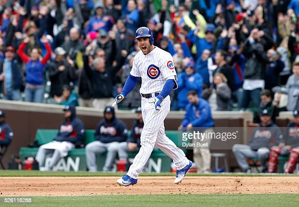 Matt Szczur of the Chicago Cubs reacts after hitting a grand slam in the eighth inning against the Atlanta Braves at Wrigley Field on April 29 2016...