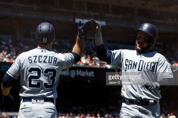 Matt Szczur of the San Diego Padres and Luis Torrens celebrate after both scored on a triple by Luis Perdomo during the fourth inning against the San...