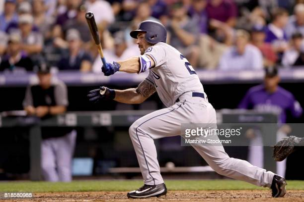 Matt Szczur of the San Diego Padres hits a RBI single in the sixth inning against the Colorado Rockies at Coors Field on July 18 2017 in Denver...