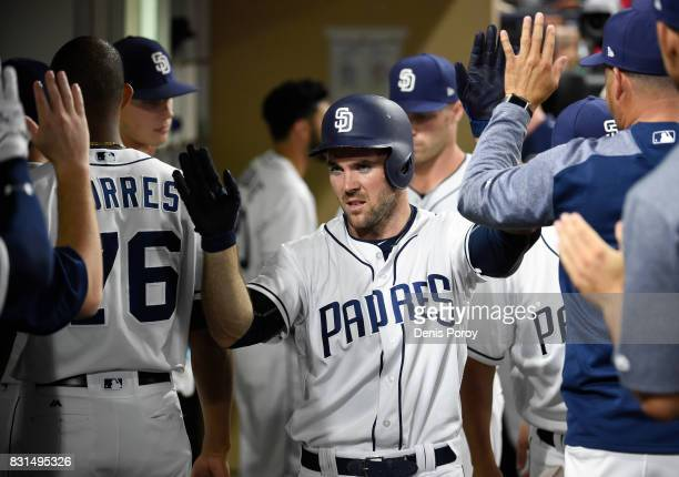 Matt Szczur of the San Diego Padres is congratulated after scoring during the sixth inning of a baseball game against the Philadelphia Phillies at...