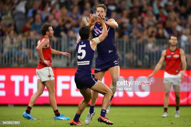Matt Taberner and Adam Cerra of the Dockers celebrate a goal during the round two AFL match between the Fremantle Dockers and the Essendon Bombers at...