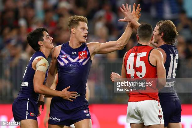 Matt Taberner of the Dockers celebrates a goal with Adam Cerra and David Mundy of the Dockers during the round two AFL match between the Fremantle...