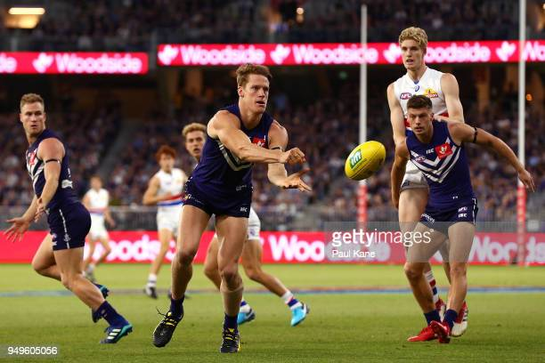 Matt Taberner of the Dockers handballs during the round five AFL match between the Fremantle Dockers and the Western Bulldogs at Optus Stadium on...