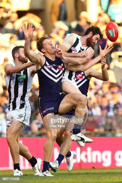 Matt Taberner of the Dockers spills a mark against Tyson Goldsack of the Magpies during the round 11 AFL match between the Fremantle Dockers and the...