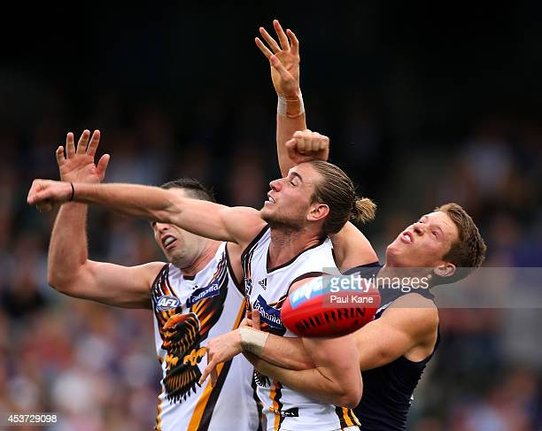 Matt Taberner of the Dockers spoils the mark for Brian Lake and Ryan Schoenmakers of the Hawks during the round 21 AFL match between the Fremantle...