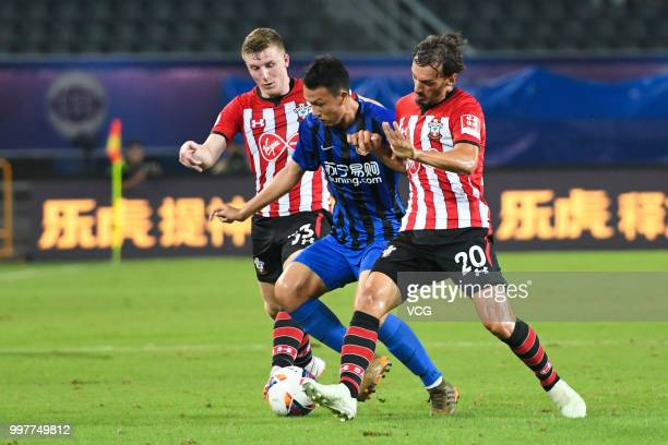 Matt Targett and Manolo Gabbiadini of Southampton compete during the 2018 Clubs Super Cup match between Southampton FC and Jiangsu Suning FC at...