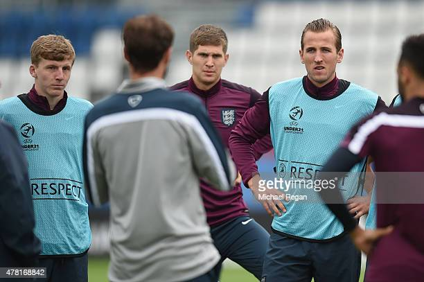 Matt Targett John Stones and Harry Kane look on during the England U21 Training Session and Press Conference on June 23 2015 in Olomouc Czech Republic