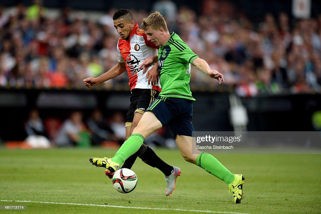 Matt Targett of Southampton vies with Bilal Basacikoglu of Feyenoord during the pre season friendly match between Feyenoord Rotterdam and Southampton FC at De Kuip on July 23, 2015 in Rotterdam, Netherlands.