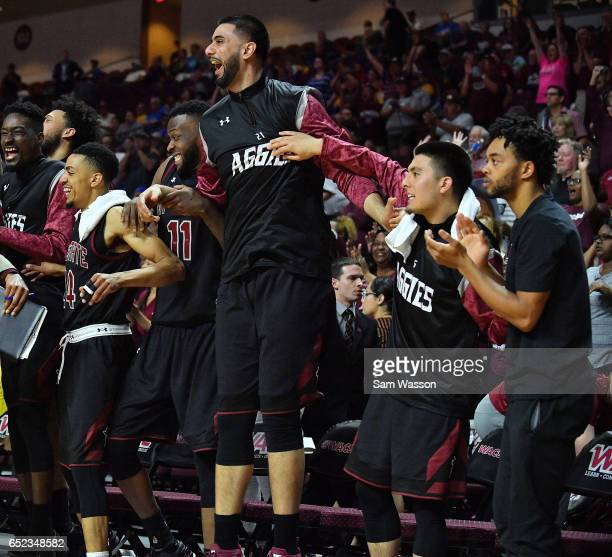 Matt Taylor Johnathon Wilkins Tanveer Bhullar Joe Garza and Travon Landry of the New Mexico State Aggies celebrate during the championship game of...