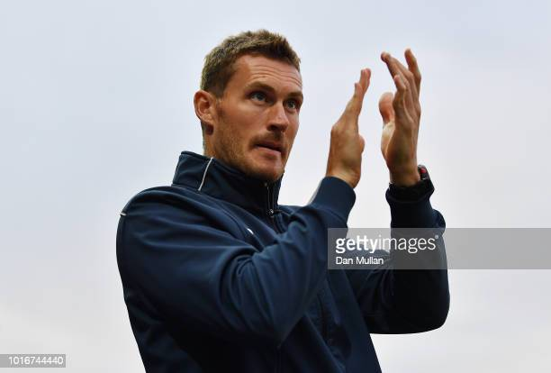 Matt Taylor, Manager of Exeter City applauds the fans during the Carabao Cup First Round match between Exeter City and Ipswich Town at St James Park...