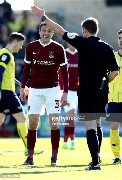 Matt Taylor of Northampton Town makes a point to referee Michael Jones during the Sky Bet League One match between Northampton Town and Oxford United...