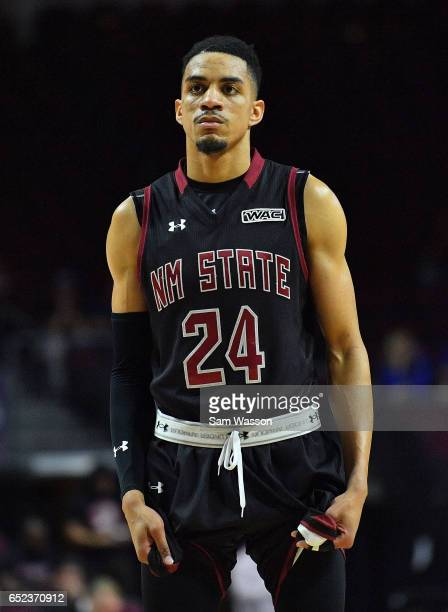 Matt Taylor of the New Mexico State Aggies looks on during the championship game of the Western Athletic Conference Basketball tournament against the...