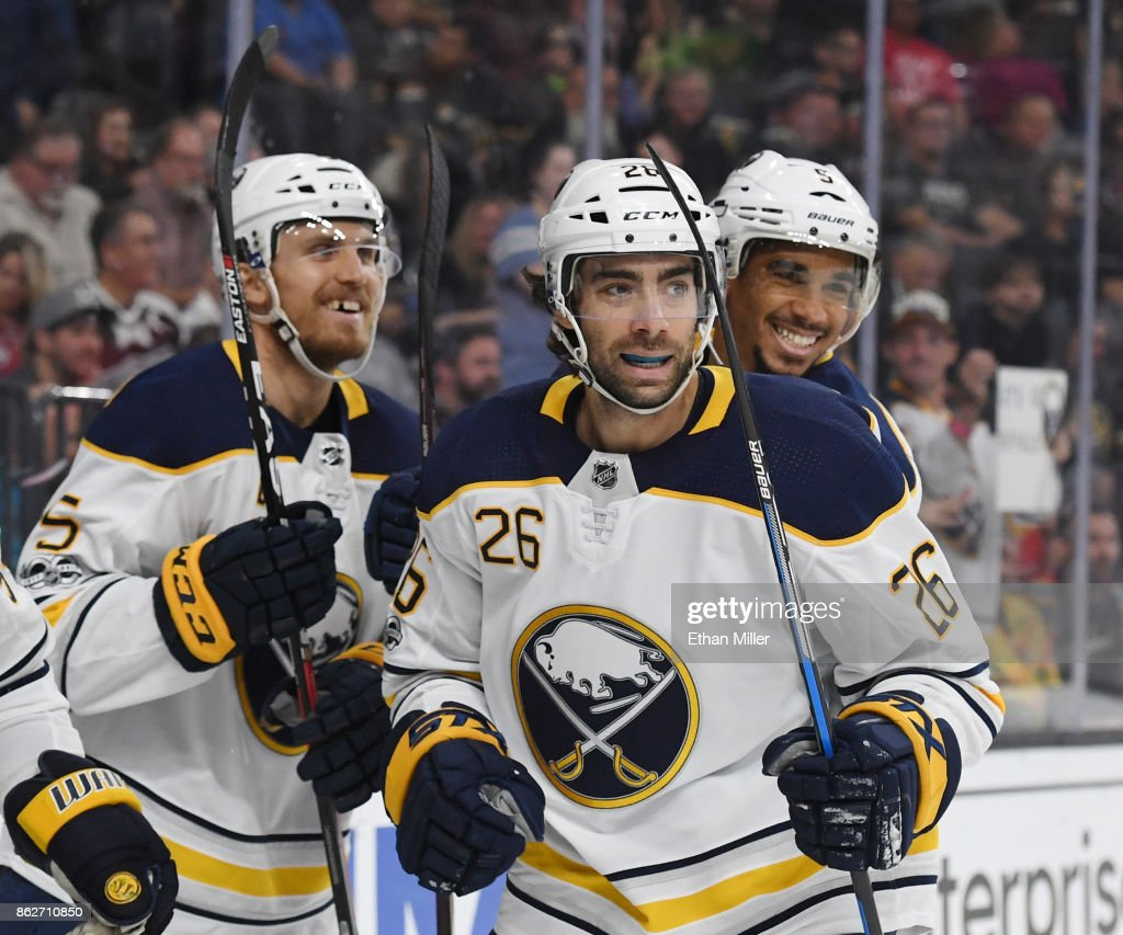 Matt Tennyson #5, Matt Moulson #26 and Evander Kane #9 of the Buffalo Sabres celebrate after a first-period goal scored by Ryan O'Reilly (not pictured) #90 against the Vegas Golden Knights during their game at T-Mobile Arena on October 17, 2017 in Las Vegas, Nevada. The Golden Knights won 5-4 in overtime.