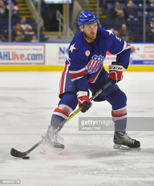 Matt Tennyson of the Rochester Americans looks to shoot during a game against the Bridgeport Sound Tigers at the Webster Bank Arena on December 10...