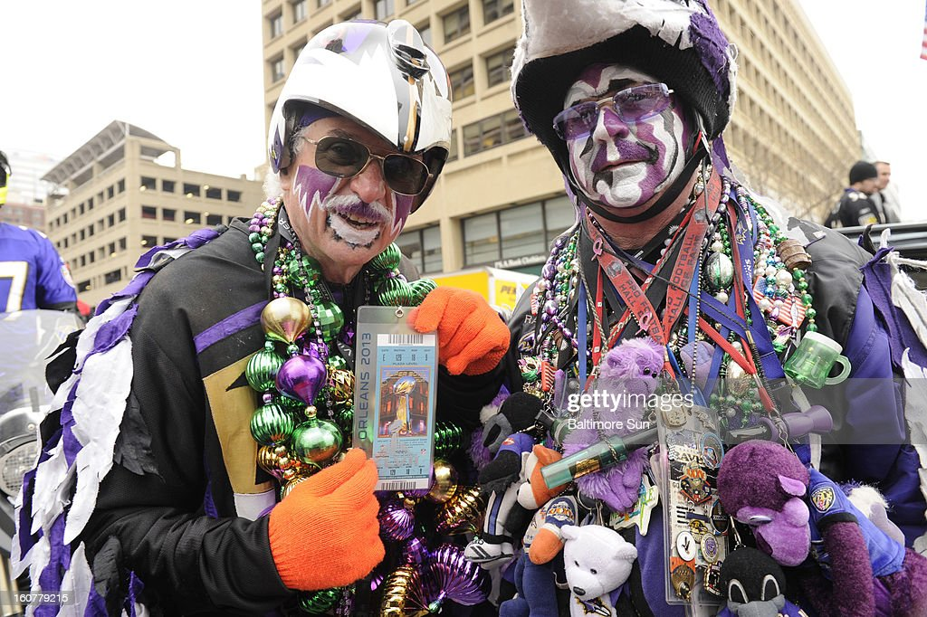 Matt 'The Fan Man' Andrews and John 'Camo Man' Dongarra join the party for the Super Bowl victory parade in Baltimore, Maryland, Tuesday, February 5, 2013.
