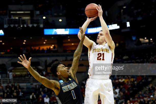 Matt Thomas of the Iowa State Cyclones attempts a shot while being guarded by Marcus Marshall of the Nevada Wolf Pack in the second half during the...