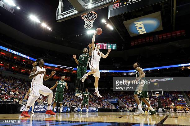 Matt Thomas of the Iowa State Cyclones goes to the hoop against Chris Cokley of the UAB Blazers during the second round of the 2015 NCAA Men's...