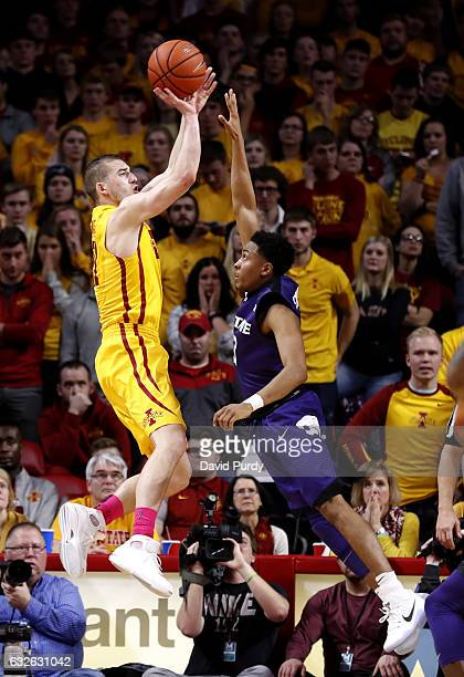 Matt Thomas of the Iowa State Cyclones takes a shot over Kamau Stokes of the Kansas State Wildcats in the second half of play at Hilton Coliseum on...